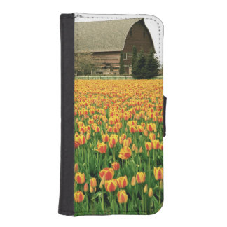 Spring tulips bloom in front of old barn. iPhone SE/5/5s wallet case
