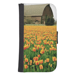 Spring tulips bloom in front of old barn. samsung s4 wallet case