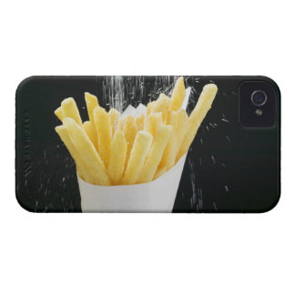 Sprinkling salt on chips in paper cone iPhone 4 Case-Mate cases