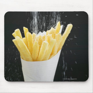 Sprinkling salt on chips in paper cone mouse mat
