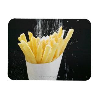 Sprinkling salt on chips in paper cone magnet