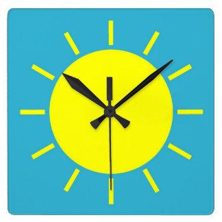 Square clock depicting yellow sunshine