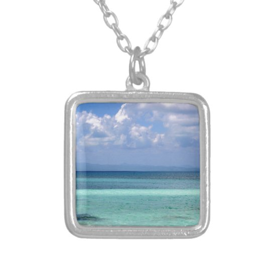 Square necklace with a photo of the Belise coastli