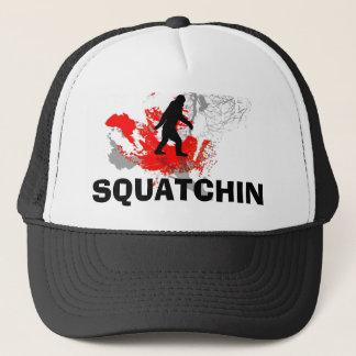 Squatchin with black bigfoot trucker hat