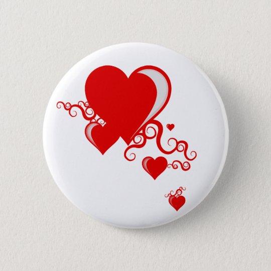 squiggle hearts. 6 cm round badge