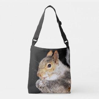 Squirrel eating a nut crossbody bag