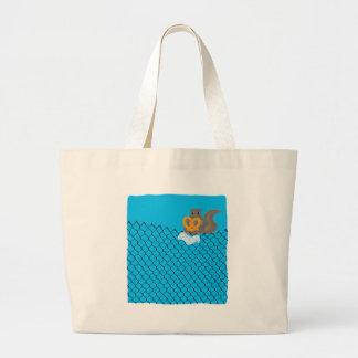 Squirrel eating pretzel bags