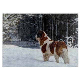 St Bernard dog in the snow Cutting Board