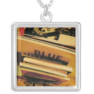Stack of books and magazines necklace
