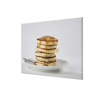 Stack of bread with honey stretched canvas print