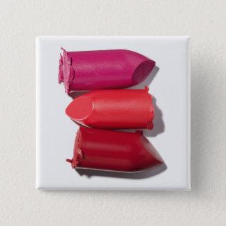Stack of broken lipstick 15 cm square badge
