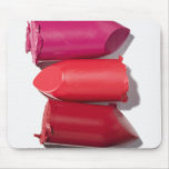 Stack of broken lipstick mouse mat