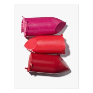 Stack of broken lipstick postcard