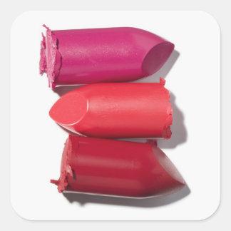 Stack of broken lipstick square sticker