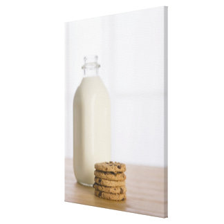 Stack of chocolate chip cookies milk in a glass canvas print