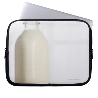 Stack of chocolate chip cookies milk in a glass laptop sleeve