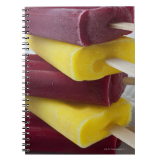 Stack of frozen ice pops, ice cream on a stick notebooks
