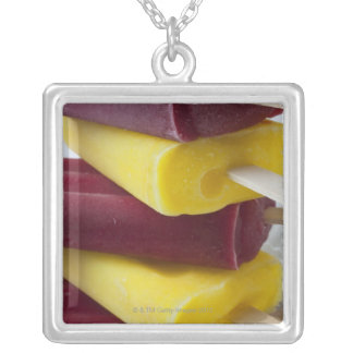 Stack of frozen ice pops, ice cream on a stick silver plated necklace