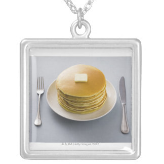 Stack of pancakes with butter on a plate square pendant necklace