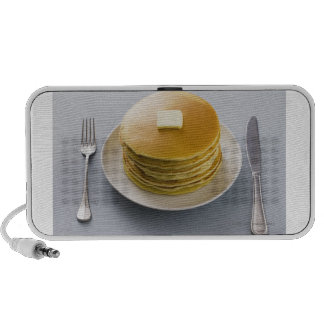Stack of pancakes with butter on a plate notebook speakers