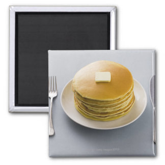 Stack of pancakes with butter on a plate square magnet