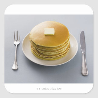 Stack of pancakes with butter on a plate square sticker
