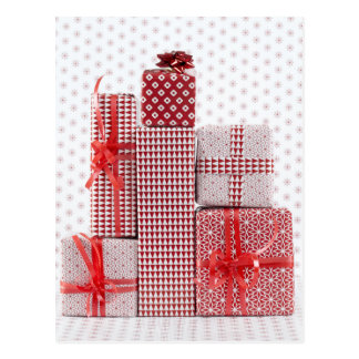 Stack of red patterned wrapped presents postcard