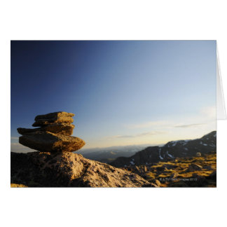 Stack of Wish Rocks balancing on a larger rock Greeting Card