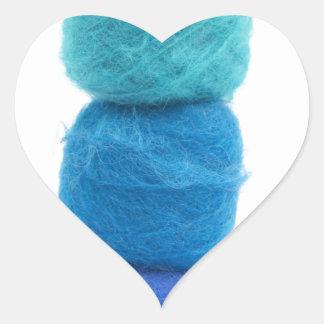 stacked balls of blue yarn heart sticker