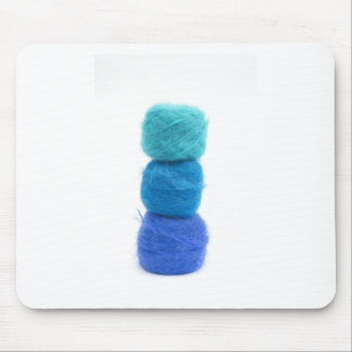 stacked balls of blue yarn mouse mat