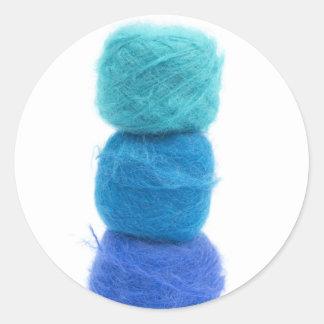 stacked balls of blue yarn round sticker