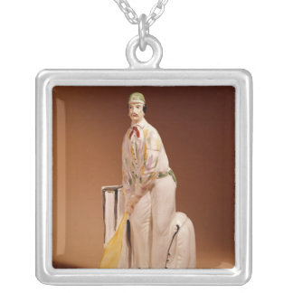 Staffordshire figure of a cricketer, 1865 silver plated necklace
