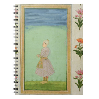 Standing figure of a boy with a jewelled dagger in spiral notebook