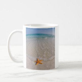 Starfish on beach coffee mug