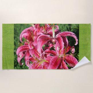 Stargazer Oriental Lilies, full flowers red Beach Towel
