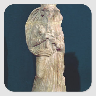 Statuette of a woman playing a double flute square sticker