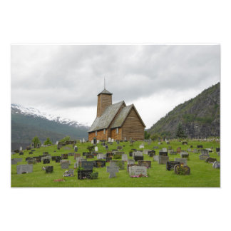 Stave church with graveyard in Norway photo