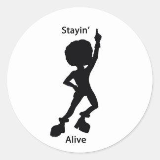 Staying alive round sticker