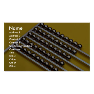 Steel balls and rods on yellow acrylic business card