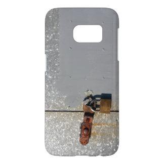 Steel doors locked with a rusty padlock