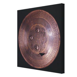 Steel shield with intricate gold decoration canvas print