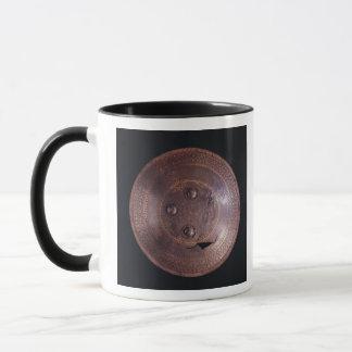 Steel shield with intricate gold decoration mug