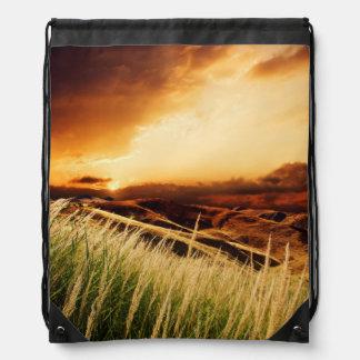 stems of rush at the sunset drawstring bag