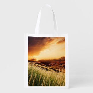stems of rush at the sunset reusable grocery bag