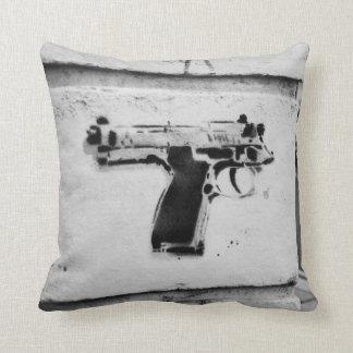 Stencil graffiti of a reverse gun pillow