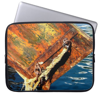 Stern of fishing boat and reflections in the water laptop sleeve