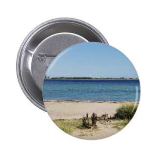 Stick button on beach and sea