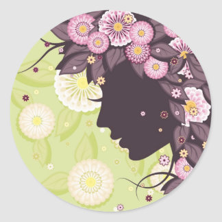 Sticker with woman face silhouette and flowers