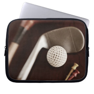 Still life if vintage golf clubs, tees and ball. laptop sleeve