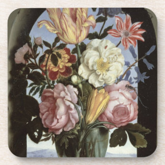 Still life of flowers in a drinking glass coaster